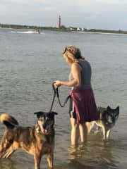 Jana and our pups on a dog beach in Florida