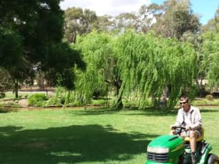 Phil mowing on a housesit property