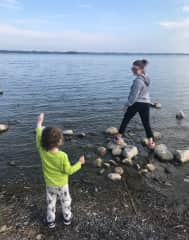 My Nephew and i skipping pebbles on a lake(he is telling me to swim across)