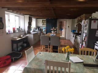 The kitchen with island, range cooker and American style fridge freezer