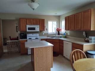 Please treat the kitchen as your own!  Dining room is at the end of the kitchen. Fridge, dishwasher, stove, microwave and island.  Keurig coffee machine and everything you need.
