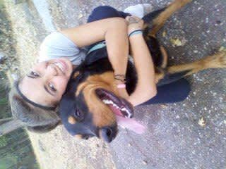 My 3rd daughter with her Rottweiler. This guy has passed over the rainbow Bridge. We will forever love him.