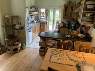 The kitchen leads onto a long garden.