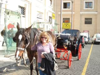 Irene getting to know one of the carriage horses at the Vatican