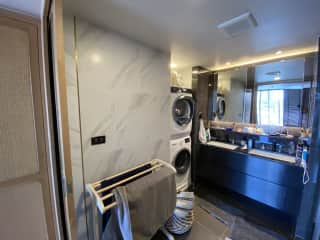 Master bathroom with laundry and dryer