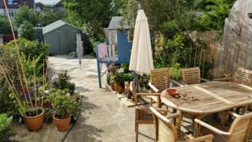 Paved back garden with patio, umbrella  and garden furnitive