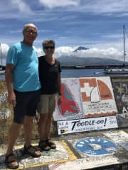 Laurie and Bill in Horta, Azores with Toodle-oo!'s harbour wall art