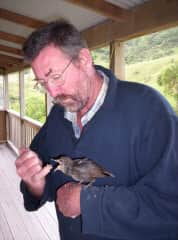 Brett and a bird we raised from a fledgling