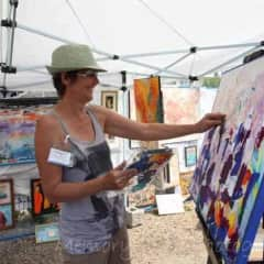 Selling and painting at an art walk in my home town.