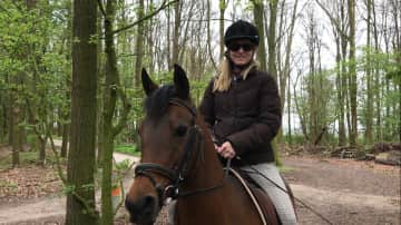 Me riding an arabian horse in the forest