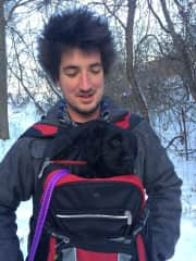 Jake keeping Steph our guide dog puppy warm