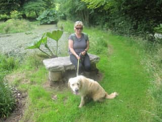 Linda with Seve resting on a bench during out 3 hour hike in Cornwall, UK