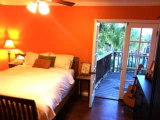 Master bedroom has corner windows, french door to small deck, ceiling fan, walk-in vanity closet, connecting master bath with full tub and separate shower. Also has small window-unit AC.