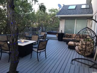 Deck with hot tub in the back. If it is ready for winter, all furniture will be stored away.