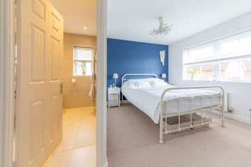 Guest Bedroom with King Double Bed, wardrobe and chest of drawers and Ensuite Shower Room