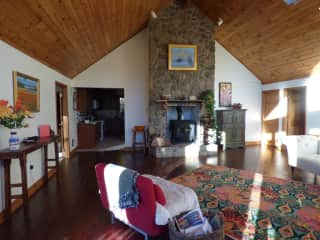 Living room, facing kitchen and bedrooms. Wood burning stove.