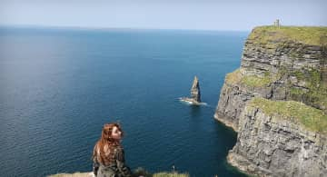 At the Cliffs of Moher! Ireland is one of my favorite places to travel. I've been back 3 times!