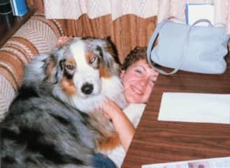 Bullit (male Australian Shepherd) snuggle time with Patty