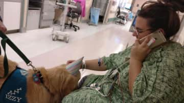 Tiffany with Oscar, the dog who used to come visit her when she was in hospital