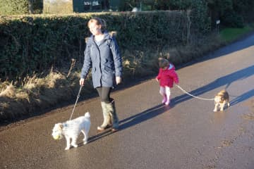 Megan and Elena walking Sabi and Stella at one of our house sits