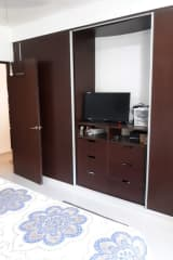 Master Bedroom closet area with TV.