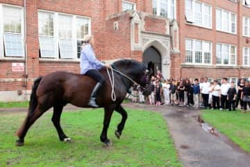 Karin riding Prinz for inner city school event about one of her books