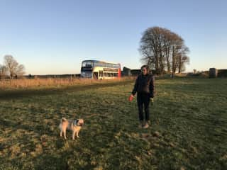 Kate taking Chewy the chubby pug for a walk in Avebury!