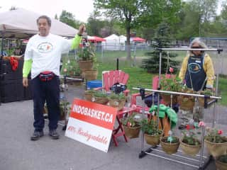 Jay and Helene at the market stall in Ottawa a couple of years ago, selling the baskets with plants.