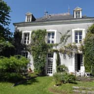 Old French maison de maitre and our two precious dogs.