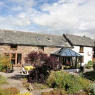 Cottage close to the English lake district with two  friendly Border terriers needing some company and walks. Also  some  plants to water .