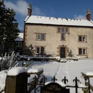 Historic house in Peak District village with cats and hens