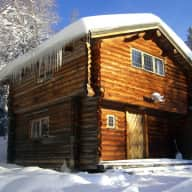 Live in a beautiful mountain cabin near a skiresort and take care of a sleddog kennel.