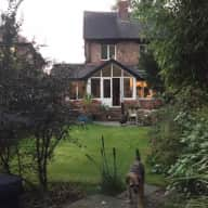 Four bedroom house with garden in south Manchester with two dogs.