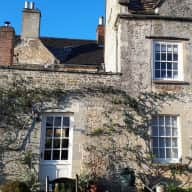 2 friendly dogs in pretty home in the Cotswolds.   Quiet location, cosy atmosphere, central heating, gorgeous walled garden.   Home to  Chippy, the fox-red labrador and   and Smartie the adorable but scruffy small terrier