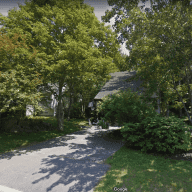 Large house with a beautiful dog in the suburbs