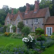 Farmhouse next to stables backing on to woods overlooking the river Thames