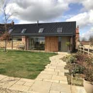 Contemporary barn conversion with superb views in South Lincolnshire, with 2 dogs, 3 sheep and 8 hens, all waiting to welcome you!!