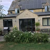 Cotswold village house with a friendly  Norfolk terrier