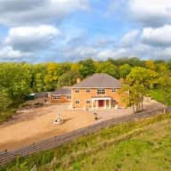 Large House set in woodland over looking river valley