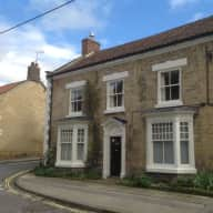 Town house with walled garden in centre of market town. Three undemanding dogs.