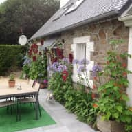 2 bedroomed south facing cottage near Perros Guirec in Brittany France .
