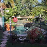 We have a lovely 4   bedroom  house, with two available for a wonderful House sitter,  in Kewarra Beach north of Cairns, 10min walk to the beach.