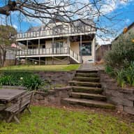 Lovable Labrador and storybook house overlooking the Royal National Park