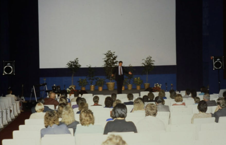 Pastor Kevin teaching in the General Cinema Theater