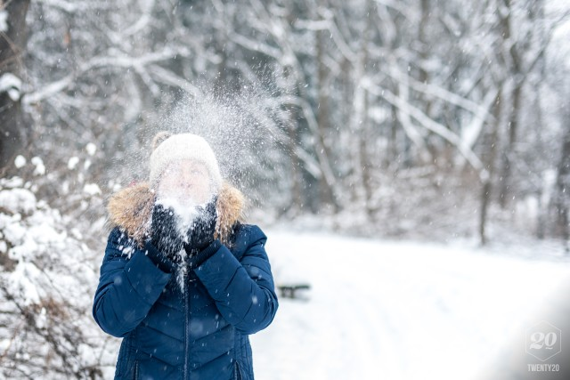e64e698718280 Happy woman blowing handful of light fluffy snow into the air! blow ...