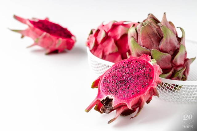 Fresh organic red dragon fruit on a white background
