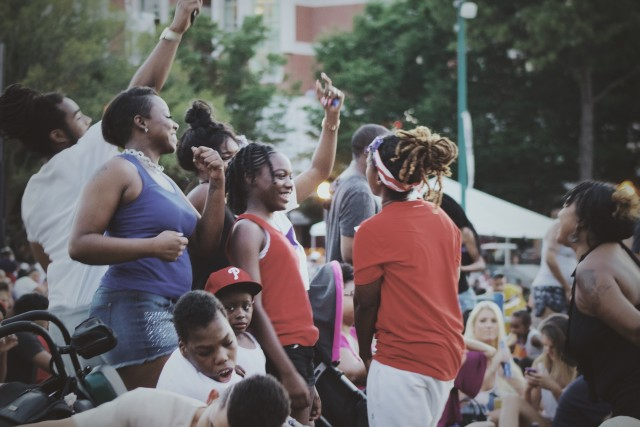 people having fun and dancing before the start of music festival evening