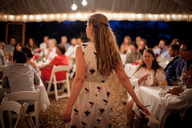 Girl standing at a wedding reception