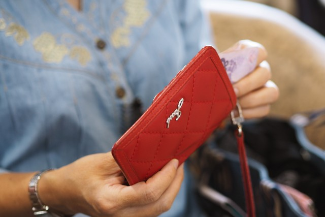 Woman and her red wallet on shopping retails