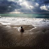Oxnard Beach in Ventura County.  My 4 1/2 year old son playing in the surf.  There was a rain storm hopefully approaching our drought ravaged state and the light was just incredible.